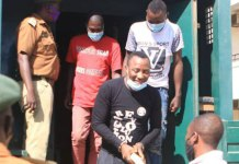 Omoyele Sowore in handcuffs
