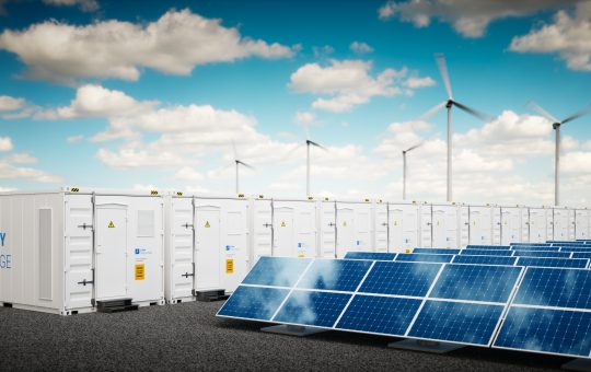 Concept of energy storage system. Renewable energy power plants - photovoltaics, wind turbine farm and  battery container. 3d rendering.