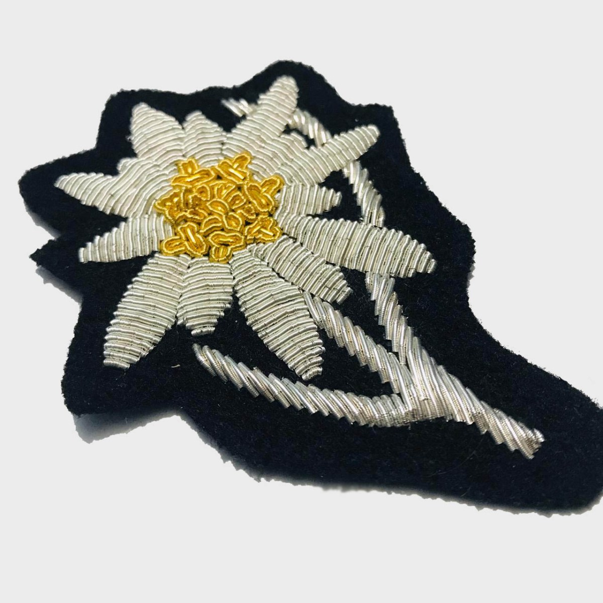 Edelweiss Flower Bullion Embroidered Badge , Sew-on Applique Patch - Edelweiss EmbroideredPatch Size # 3inches Sew-on backing Silverbullion wires embroidered on felt  4