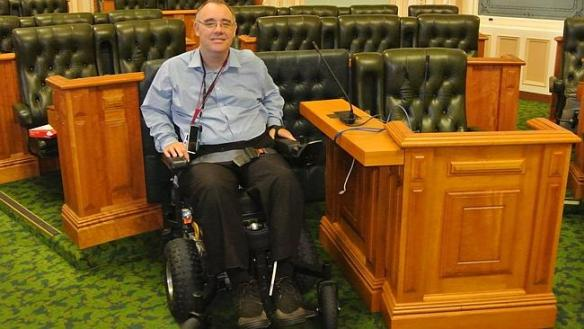 "Rob Pyne in his mofified parliamemt chamber ""seat"""