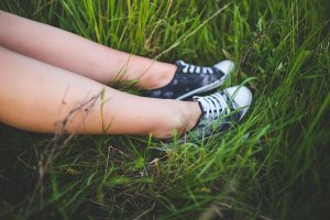 teenager's legs in the grass