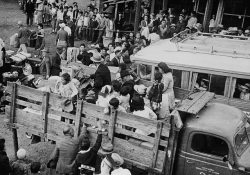 Japanese-Canadians being transported to detention camps
