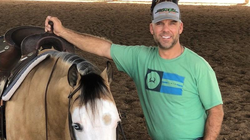Craig Schmersal standing by horse
