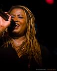 red dot Singer Voice Performance Coach Motivational Speaker Acto