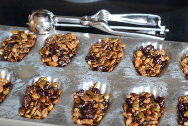 Make you own fruit and nut snack bars using a madeline pan.  Snack Bar Madeleines are a healthy treat that require only 15 minutes of baking time. | QueenofMyKitchen.com