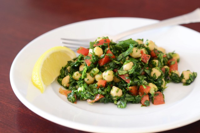 Chickpea Spinach Salad is a simple, healthy, and versatile salad that can be served as a main dish, side dish or appetizer.   QueenofMyKitchen.com