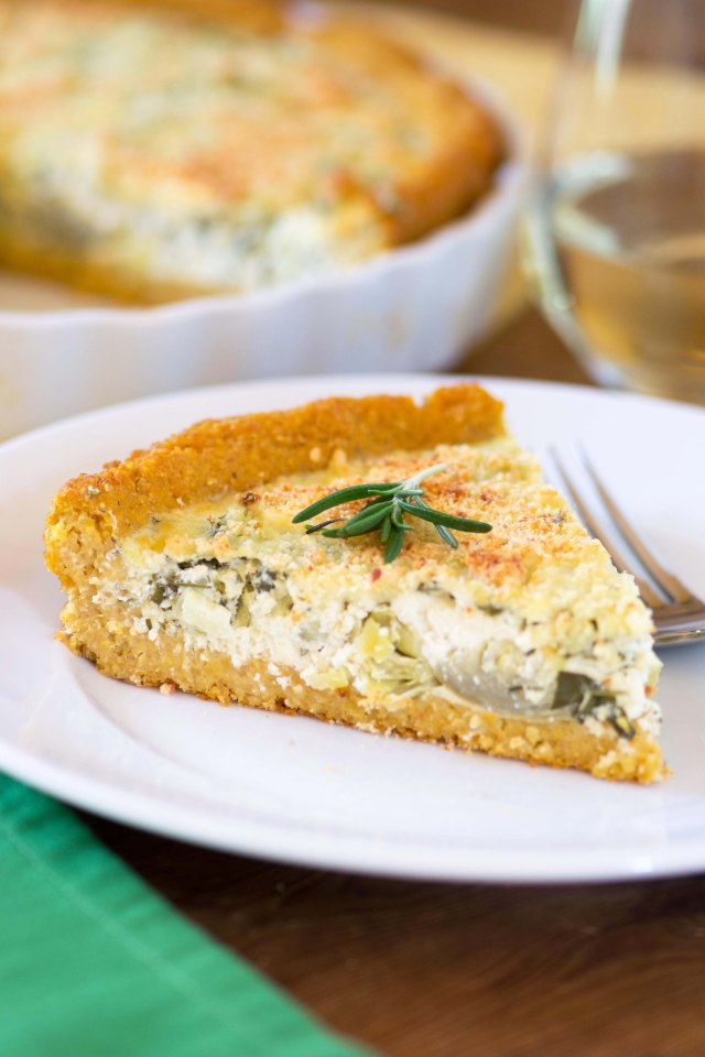Artichoke Rosemary Tart with Polenta Crust - A gluten-free, vegetarian tart with a polenta crust and a filling made of Greek yogurt infused with fresh herbs. The best part about this tart - no rolling pin needed! | QueenofMyKitchen.com