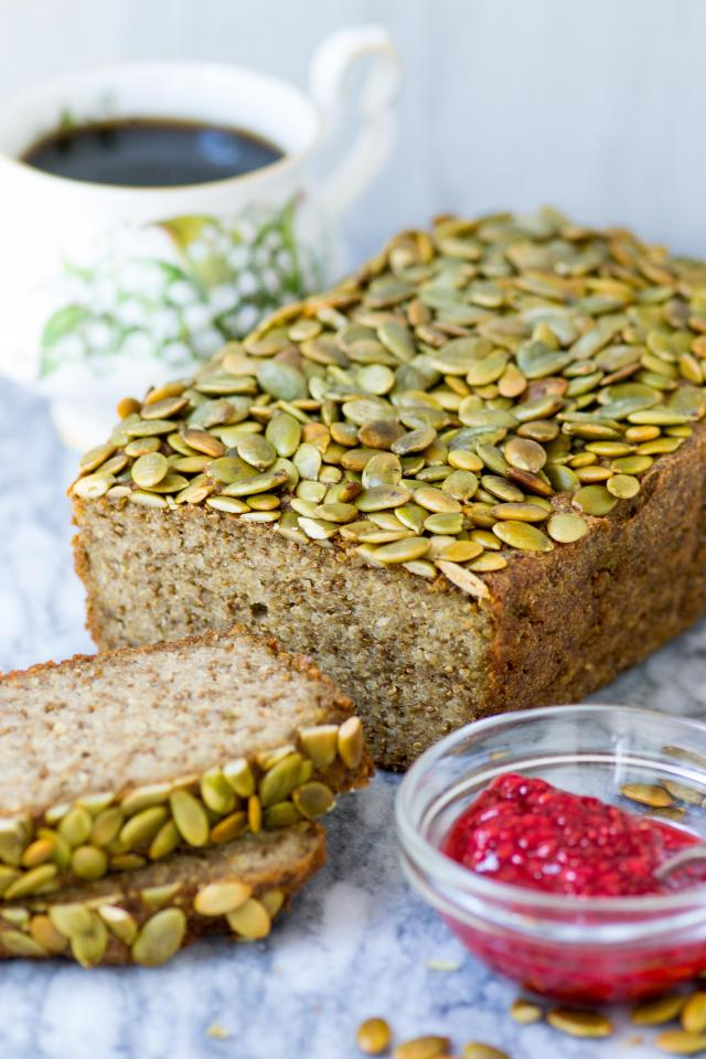 Pepita Quinoa Chia Bread is gluten-free, dairy-free, and vegan. A delicious yeast-free bread that's high in protein, fiber, and healthy fats. | QueenofMyKitchen.com