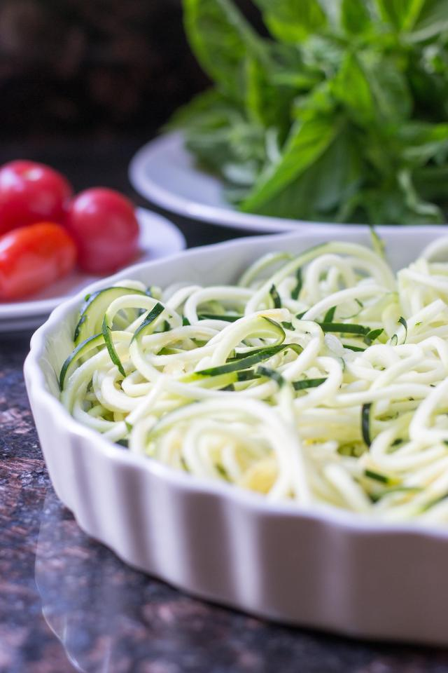 Baked Zoodles Caprese is made with zucchini noodles and tastes like lasagna. A light dish, with zesty Italian flavor and under 200 calories per slice. | QueenofMyKitchen.com