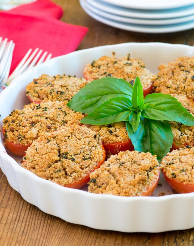 Gluten Free Tomatoes Provencal – a classic side dish made gluten free. Quick and easy. Stuffed with goat cheese and pine nuts. Great for entertaining or casual family dinners. | www.QueenofMyKitchen.com