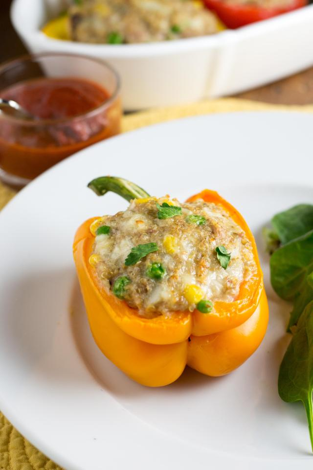 Turkey Cheddar Quinoa Stuffed Peppers - Nutritious AND budget friendly. If you New Year's resolution is to eat healthier and save more money, this dish is for you! | QueenofMyKitchen.com