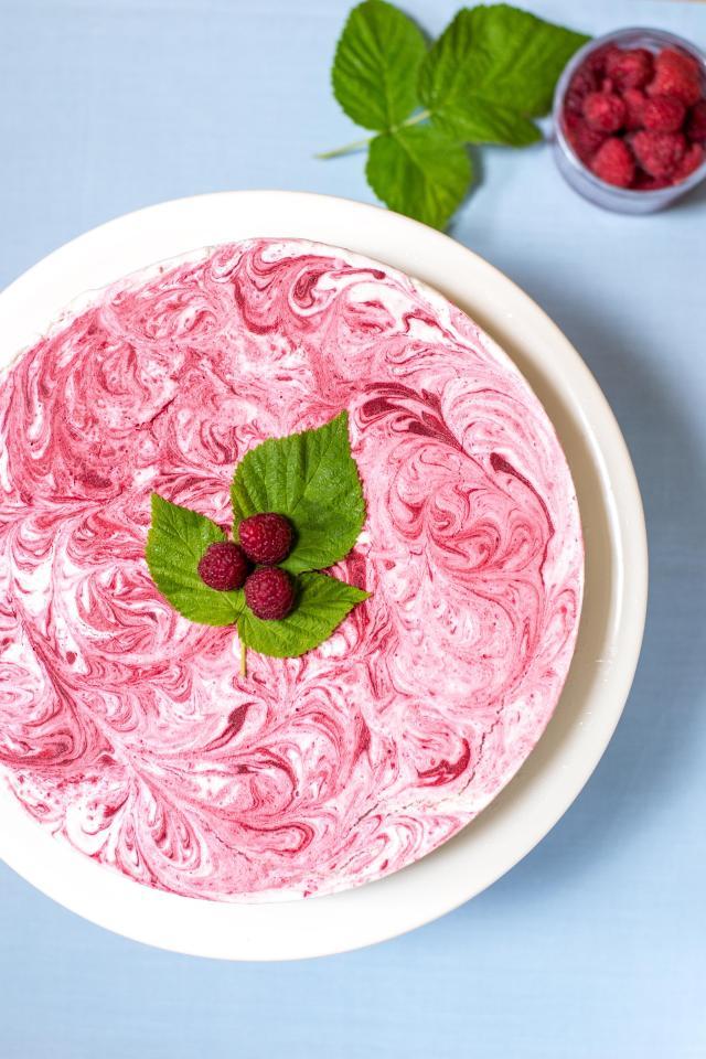 Raspberry Vanilla Swirl Ice Cream Pie with Maple Almond Cookie Crust – Raspberry purée is swirled into sweet, creamy vanilla ice cream on top of a delicious gluten-free cookie crust. An impressive, semi-homemade dessert. | QueenofMyKitchen.com