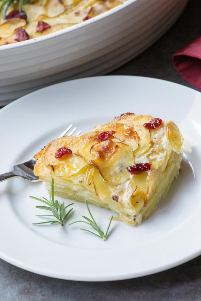 Cranberry Spice Scalloped Potatoes – A festive twist on a classic recipe. Rich, creamy, and delicious, this side dish is perfect for holiday entertaining and so easy to make. | QueenofMyKitchen.com #scallopedpotatoes #potatoes #potatorecipes #PotatoRecipe #side #sidedish #holidaysides #holidaysidedish #holidayfood #comfortfood #boursin #boursincheese