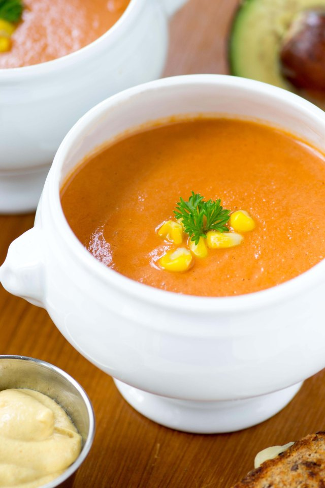 Creamy Tomato Corn and Avocado Blender Soup - A velvety soup you can whip up in a matter of minutes. The easiest soup you'll ever make! Gluten-free. | QueenofMyKitchen.com #soup #tomatosoup #creamoftomatosoup #tomatorecipes #tomatosouprecipe #blendersoup #souprecipes