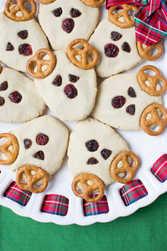 Vegan Rudolph Reindeer Cookies – An easy and fun Christmas cookie recipe. Even young children can help make these. Soft and chewy with a super clean taste. Gluten-free and dairy-free.   QueenofMyKitchen.com #christmascookies #cookies #christmas #cookiesforsanta #christmasbakingforkids #christmasbaking #vegan #christmasvegan #vegancookies #christmascookieseasy