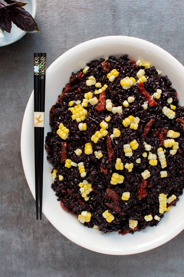 (#AD) Black Rice and Sweet Summer Corn Salad – A healthy, easy-to-make whole grain salad with sweet corn, savory sun-dried tomatoes, and fresh basil. Vegan, gluten-free, and dairy-free. | QueenofMyKitchen.com | #blackrice #forbiddenrice #sides #vegansidedish #glutenfreesidedish