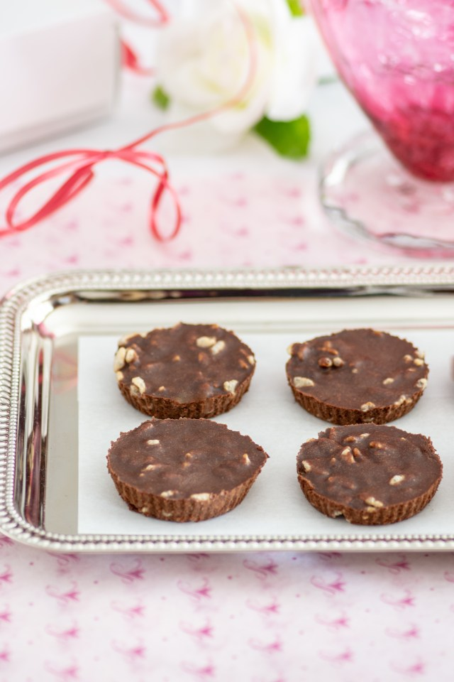 Dairy Free Crispy Chocolate Cups - Candy is dandy as in these easy to make dairy-free chocolate treats sweetened with maple syrup.   QueenofMyKitchen.com   #candy #chocolate #dairyfree #dairyfreechocolate #valentinesday #norefinedsugar #cleaneating #healthycandy