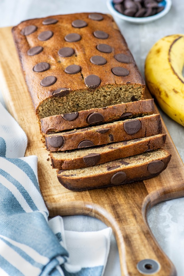 Chickpea Chocolate Chip Banana Bread – This moist delicious bread has twice the protein and fiber as most banana bread thanks to super nutritious chickpea flour. One of the best uses ever for overripe bananas! | QueenofMyKitchen.com | #bananas #healthybaking #bananabread #chickpeaflour #garbanzobeanflour