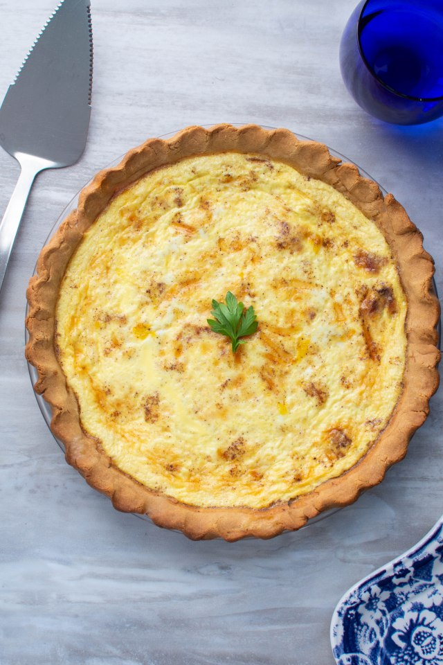 Classic Quiche Lorraine with a Chickpea Flour Crust - One of your favorite French foods just got healthier! This quiche is every bit as delicious as traditional quiche Lorraine with an easy-to-make, nutrient dense, gluten-free pie crust. | QueenofMyKitchen.com | #quiche #quichelorraine #chickpeaflourcrust #glutenfreepiecrust #glutenfreecrust