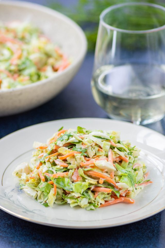 Brussels Sprouts Coleslaw – A fantastic alternative to traditional coleslaw in a healthier, lighten up dressing made with Greek yogurt and avocado mayonnaise. | QueenofMyKitchen.com | #coleslaw #brusselssprouts #salad #salads