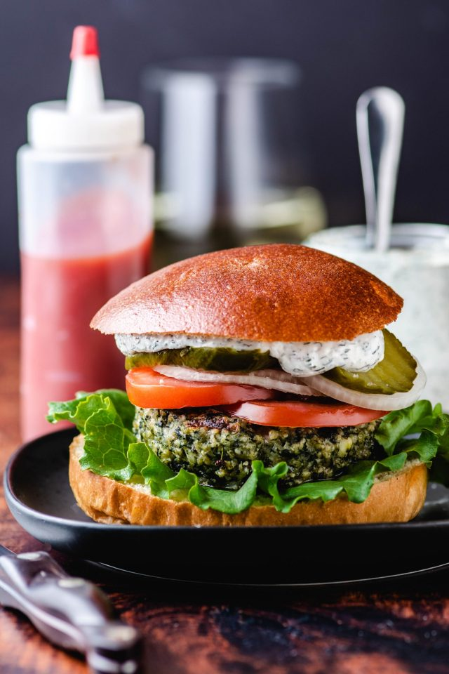 These Greek Turkey Burgers contain spinach and feta and are packed with so much savory Mediterranean flavor. Great for summertime grilling | QueenofMyKitchen.com | #burgers #turkeyburgers #grillseason #Greekfood