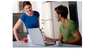 couple in kitchen on computer