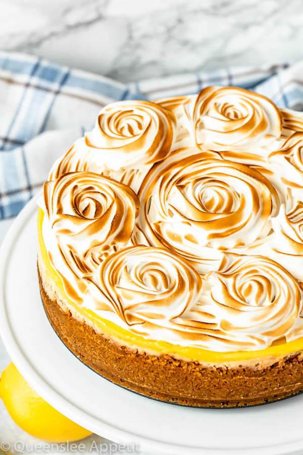 graham cracker crust, lemon cheesecake, lemon curd topping, meringue rosettes