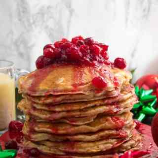 These fluffy, golden Eggnog Pancakes are spiked with rum and have a delicious Eggnog flavour. Top this stack of Christmas flapjacks with fresh cranberry syrup for a delightful holiday breakfast!