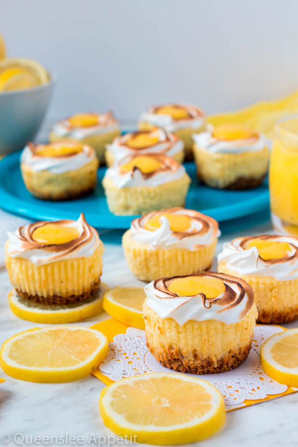 These Mini Lemon Meringue Cheesecakes are incredibly delicious and full of fresh lemon flavour! They're made with a buttery graham cracker crust, creamy lemon cheesecake filling, and are topped with a ring of toasted meringue with tart lemon curd in the centre. A fun bite-sized treat for summer!