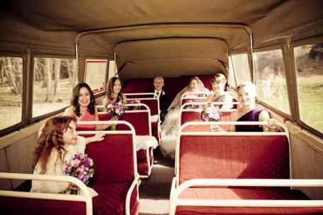 Bridal party sitting inside one of the Remarkable Experience vintage Chevrolet convertible buses for wedding transport