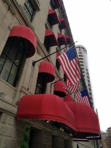 British red awings let you know you are at the Langham Hotel Boston.