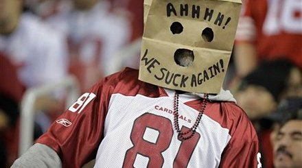 An Arizona Cardinals fan shows his opinion of the team during the third quarter of the Cardinals' NFL football game against the San Francisco 49ers on Monday, Nov. 29, 2010, in Glendale, Ariz. (AP Photo/Paul Connors)