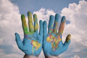 hands with global map on them