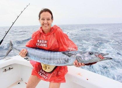 Woman holding a mackerel