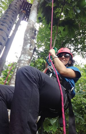 Ana Maria Torres climbing a tree