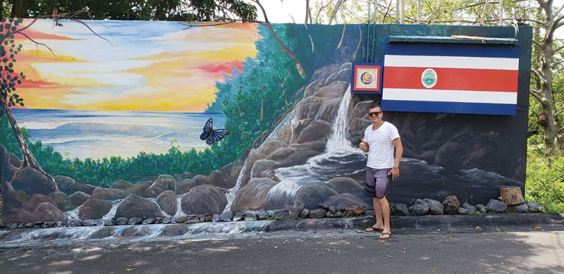 Artist Juan with the mural