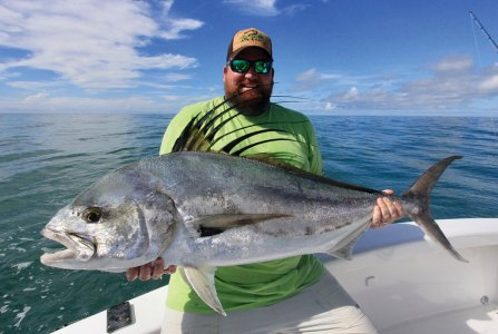 Man holding roosterfish