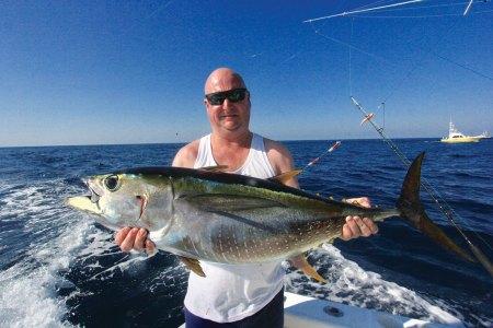Man holding a tuna