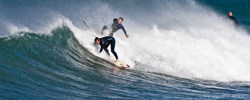 Surfer crashing into another surfer