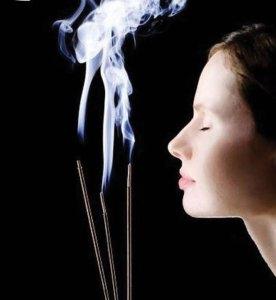 woman inhaling incense