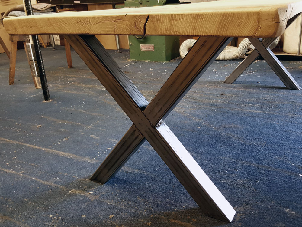 Single Slab Waney Edge Table with metal base.