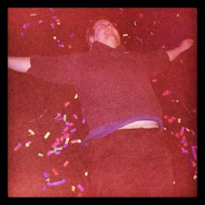 """Making a karaoke confetti snow angel on the stage of Feather Fall Casino Brewing Co. during the Karaoke Rockstaz show.  (Karaoke Rockstarz image from <a href=""""http://www.facebook.com/KRockstarz"""">facebook.com/KRockstarz</a>)"""