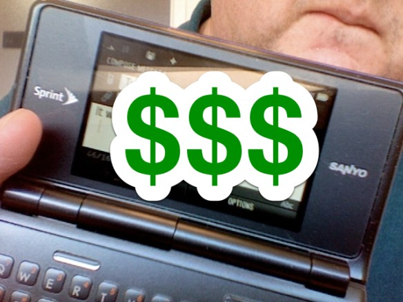 Dollar signs are superimposed over my Sanyo/Kyocera featurephone.