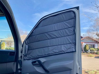 Window cover on Sprinter passenger door open