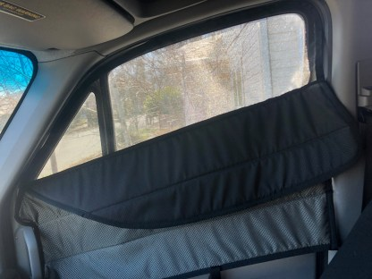 Sprinter van passenger door window cover with flip down vent