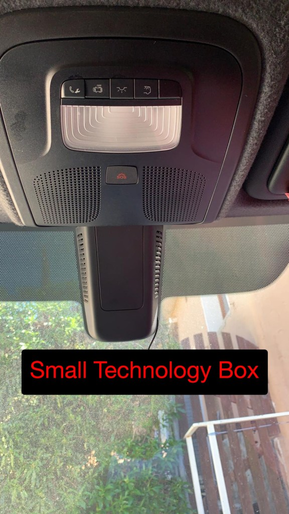 Small technology box on windshield
