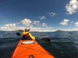 Isabelle kayaks on Lake Titicaca
