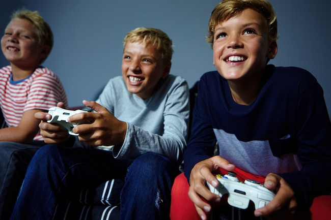 Young kids playing video games