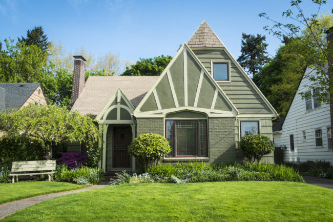 Single-family American craftsman house with blue sky background