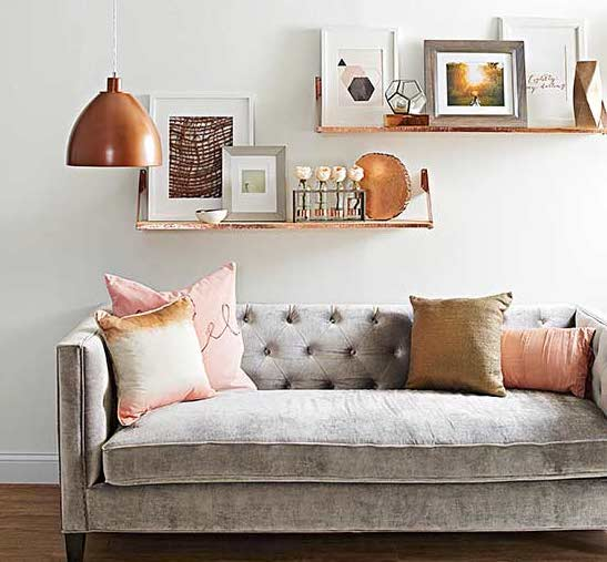 Neutral living rooms with copper accent pieces